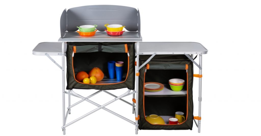 Typical camping kitchen with multiple work surfaces, cupboards and shelves