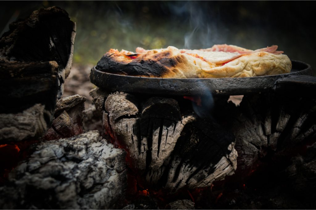 Campfire Pizza (slightly singed) cooked on an iron skillet