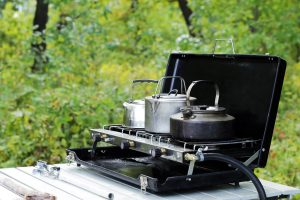 Propane gas camping stove on a folding camping table