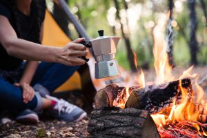 Coffee Pot Over Campfire in front of tent