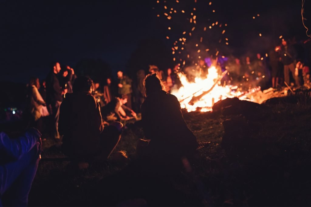 Group of campers around a large campfire