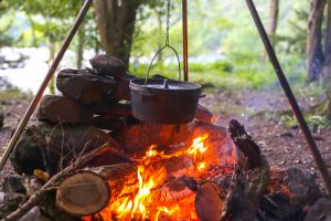 Collapsible iron tripod for cooking over campfire
