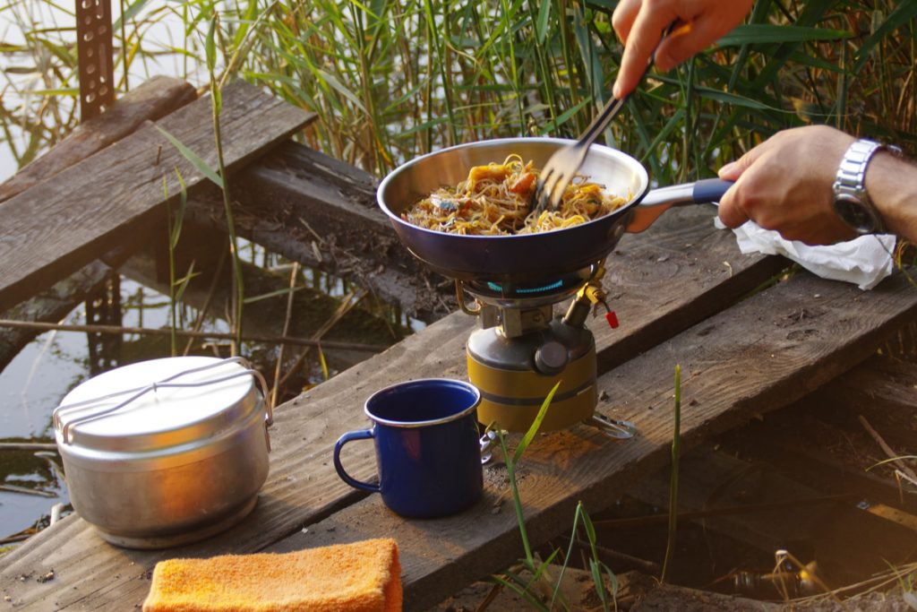 Cooking delicious food over a camping stove