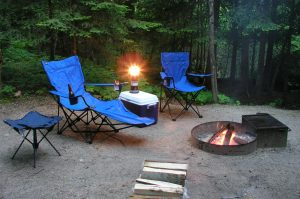 Range of camping chairs: stool, recliner and chair, in a front country campsite