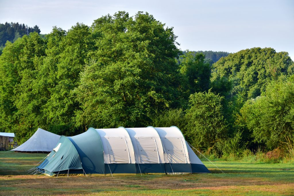 Large tunnel tent - largely freestanding but needs guy ropes staking at the ends to be stable