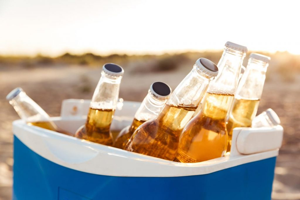 How To Get The Most From Your Cooler While Family Camping- bottles of beer in a cooler