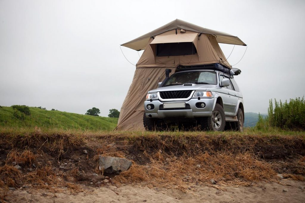 car with large roof tent - ideal for in-car camping